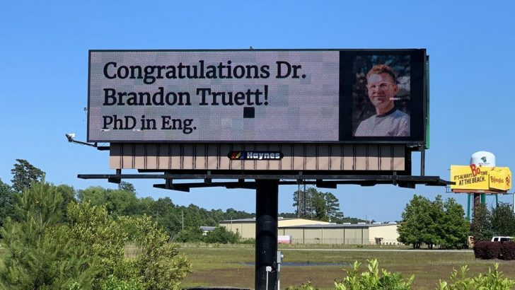 Parents surprise son with congratulations billboard after graduation was canceled